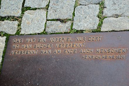 "Plaque at the Nazi book burning memorial on Bebelplatz in Berlin, Germany. The plaque has a quote from Heinrich Heine's play Almansor (play, written 1821-1822). ""Where they burn books, in the end they will also burn human beings"" (Dort, wo man Bucher verbrennt, verbrennt man am Ende auch Menschen) about burning of Quran in Granada that was expected to be followed by burning humans (Muslims then Jewish) in 1500s. Plaque at Bebelplatz.jpg"