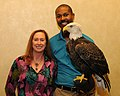 Posing for picture with Bald Eagle. (10594742284).jpg