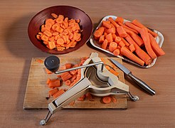 Preparing and slicing carrots.jpg