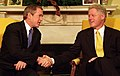 President Bill Clinton and President-Elect George W. Bush shake hands during their meeting in the Oval Office (1).jpg