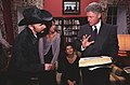 President Bill Clinton and musician the Edge look at a book.jpg