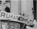 President Harry S. Truman standing in an open car, speaking into microphones, Washington, DC. President Truman had... - NARA - 199965.tif