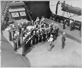 President Truman listens to the ship's band on the U. S. S. Augusta as he prepares to leave for the United States... - NARA - 198722.tif