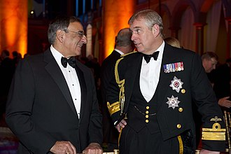 Prince Andrew, Duke of York - The Duke of York with the US Secretary of Defense Leon Panetta commemorating the 100th anniversary of Naval Aviation at the National Building Museum in 2011
