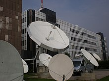Light-colored satellite dishes on the HRT building in Zagreb