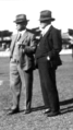 Queensland State Archives 3817 Major General Spencer Brown right and Professor Goddard left in ring at RNA Show 1930.png