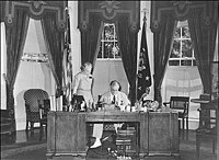 Franklin D. Roosevelt seated at the Hoover Desk