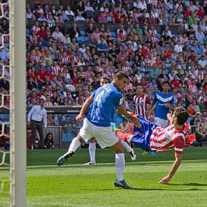 Raúl García (footballer) - García (right) in action against Almería in September 2013