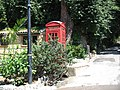 Red phone box - Gibraltar Botanic Gardens 2.jpg