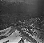Redoubt Glacier and Volcano, mountain glacier partially covered in rocks, September 4, 1977 (GLACIERS 6763).jpg
