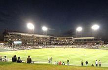 Baseball stadium at night from center field.