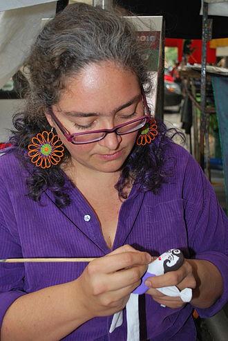 Ana Karen Allende - Ana Karen Allende painting a doll