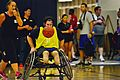 Retired U.S. Navy Explosive Ordnance Disposal Technician 1st Class John Kremer dribbles the ball down the court during a wheelchair basketball game against the Air Force team during the Wounded Warrior Pacific 140109-N-HA927-005.jpg