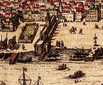 Dibujo del siglo XVI del Palacio de Ribeira. El palacio es el edificio perpendicular al Tajo, con una torre central y una terraza cercana al río. A la izquierda hay un astillero (Ribeira das Naus) con algunos barcos a medio construir. El área abierta de la derecha es la plaza del palacio (Terreiro do Paço), con un muelle y una picota.