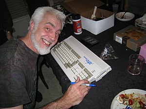 Robert J. Mical - RJ Mical signing an Amiga 1200 for the 25th anniversary of the Amiga computer, 2011