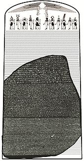 """Image of the Rosetta Stone set against a reconstructed image of the original stele it came from, showing 14 missing lines of hieroglyphic text and a group of Egyptian deities and symbols at the top"""
