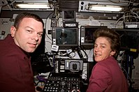 STS-114 James Kelly and Wendy Lawrence at Canadarm2 controls