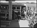 San Bruno, Calfiornia. San Francisco family end first stage of evacuation and are seen leaving the . . . - NARA - 537489.tif