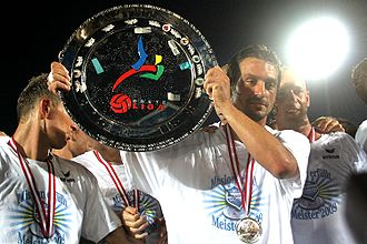 Austrian Football Second League - Sanel Kuljic of SC Wiener Neustadt lifts the Erste Liga trophy in 2009