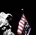 Schmitt with Flag and Earth Above - GPN-2000-001137.jpg