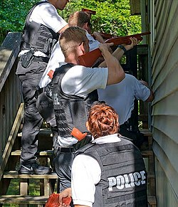 Secret Service agent trainees practice executing a search warrant.jpg