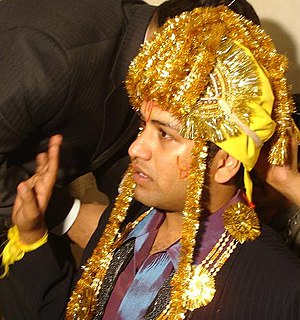 Punjabi wedding traditions - A groom with sehra.