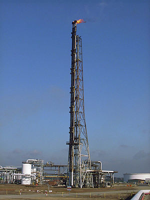 Gas flare - Flare stack at the Shell Haven refinery in England.