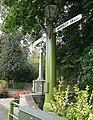 Signpost and War Memorial - geograph.org.uk - 994780.jpg