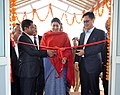 Smriti Irani accompanied by the Chief Minister of Meghalaya, Dr. Mukul Sangma and the Minister of State for Home Affairs, Shri Kiren Rijiju inaugurating the Apparel & Garment Making Centre, at Hatisil, Ampati, in Meghalaya.jpg