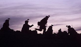 Operation Anaconda - U.S. soldiers from the 10th Mountain Division (Light Infantry) prepare to dig into fighting positions during Operation Anaconda in March 2002.