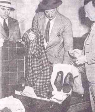 Tamam Shud case - Suitcase and effects, found at Adelaide railway station. From left to right are detectives Dave Bartlett, Lionel Leane, and Len Brown