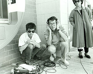Filmmaking - Sound recordist Curtis Choy (left) on location for Dim Sum: a Little Bit of Heart, an indie film by director Wayne Wang (center) on Clement Street in the Richmond District of San Francisco, California 1983. Photo by Nancy Wong