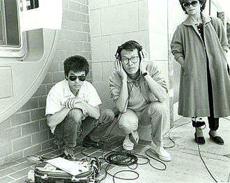 Filmmaking - Sound recordist Curtis Choy (left) on location for Dim Sum: a Little Bit of Heart, an indie film by director Wayne Wang (center) on Clement Street in the Richmond District of San Francisco, California 1983