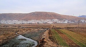 South Pyongan Province - A typical settlement along the main road in South Pyongan Province near Pyongsong.