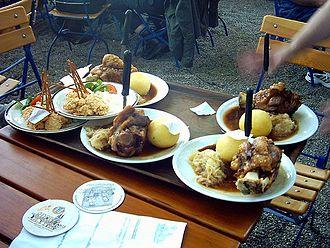 Bavarian cuisine - Schweinshaxn and Obatzder in a beer garden