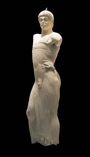 Marble statue of a young male charioteer