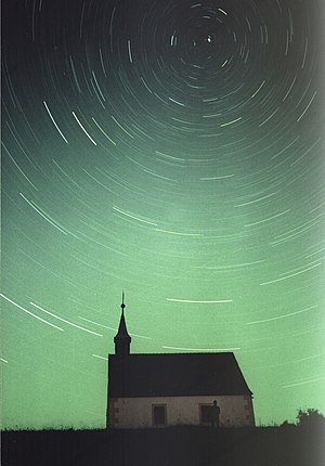 Pole star - A long exposure (45 min.) photo of Polaris and neighbouring stars, taken at Ehrenbürg (Franconia), 2001.