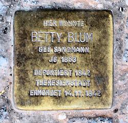 Photo of Betty Blum brass plaque