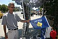 Street vendor shows off the new Kosovo flag.jpg