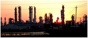 September sunrise over a chemical plant on the...