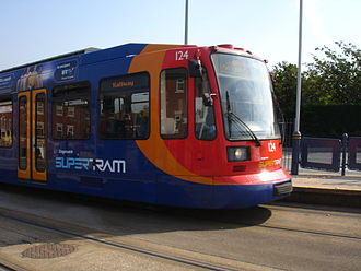 Sheffield Supertram - Siemens-Duewag Supertram 124 arriving at Gleadless Townend tram stop, on the Blue Route to Halfway