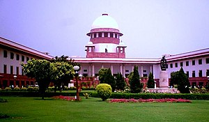 Supreme Court of India - Supreme Court building with the sculpture in the foreground