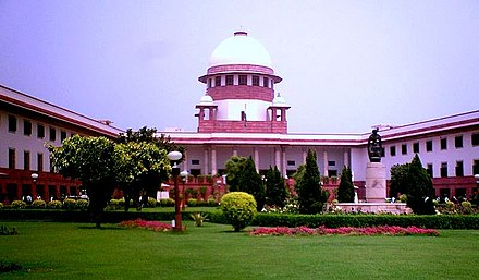 Supreme Court building with the sculpture in the foreground Supreme Court of India - Retouched.jpg