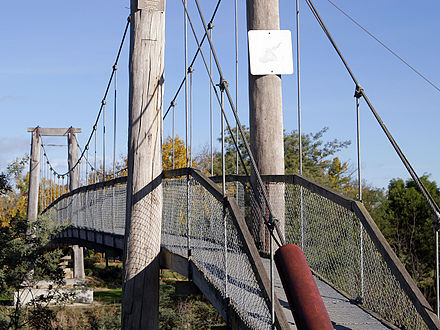 A suspension bridge can be made out of simple materials such as wood and common wire rope. Suspension bridge.jpg