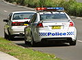 Sutherland 213 Commodore SS traffic stop - Flickr - Highway Patrol Images.jpg