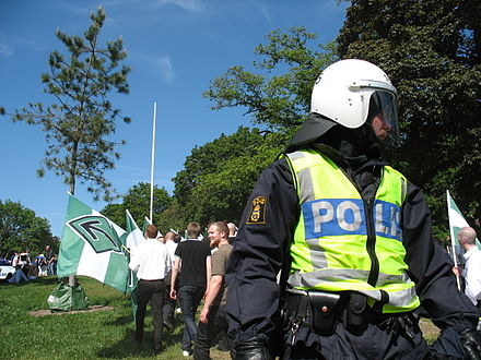 Police, like this Swedish police officer in riot gear at a 2007 demonstration, may use pepper spray to control civilians. Swedish riot police at nationalist demo.jpg
