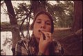 TEENAGE GIRL SMOKING POT IN CEDAR WOODS WHILE ON AN OUTING WITH FRIENDS NEAR LEAKEY, TEXAS. (TAKEN WITH PERMISSION)... - NARA - 554905.tif