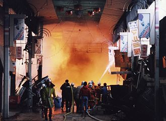 Parable of the broken window - Firefighters at work in the Taisho-suji Market in Kobe, Japan after a 1995 earthquake.