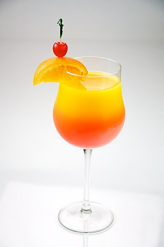 Tequila Sunrise (cocktail) - Shows a Tequila Sunrise demonstrating its resemblance to a sunrise. Shown in a stemware rather than the usual collins glass