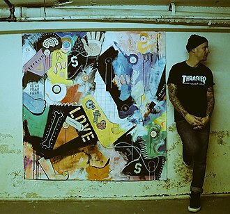 Terry Urban - Terry Urban standing by his painting